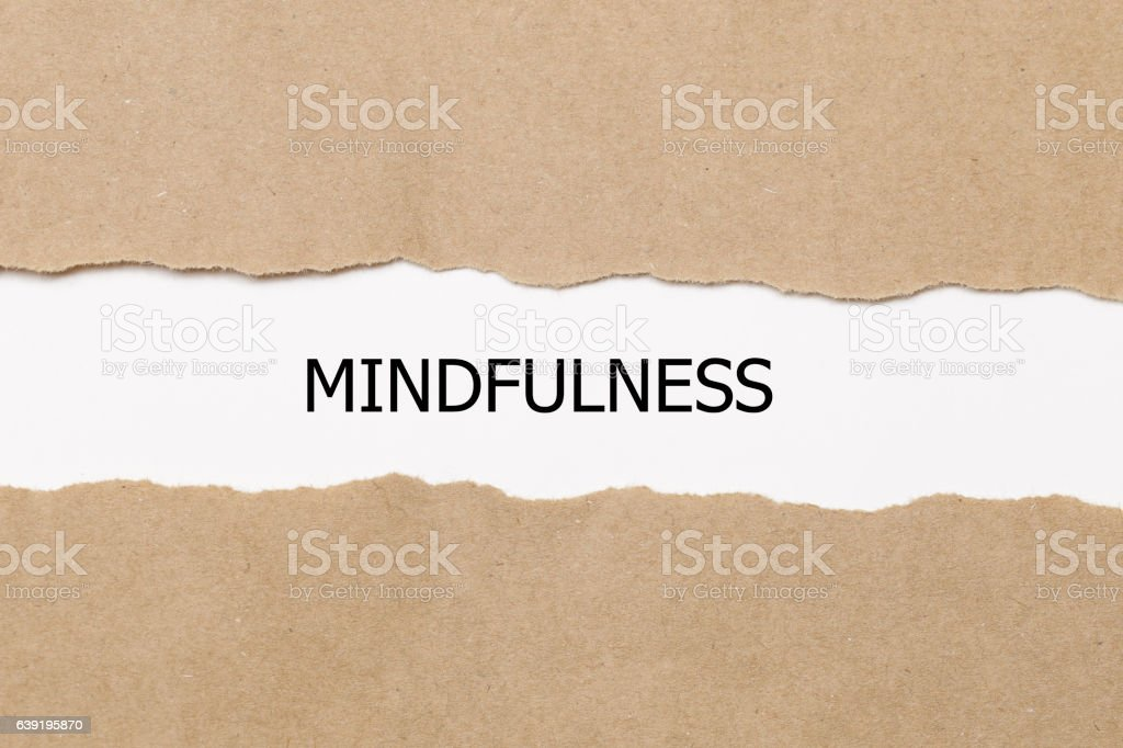 Mindfulness word written under torn paper stock photo