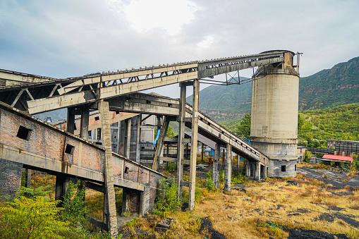 Mine facility construction conveyor belt