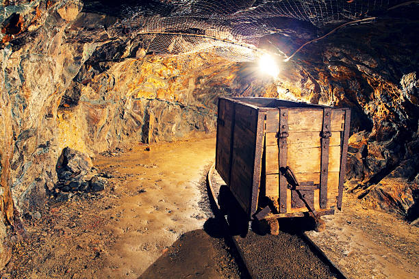 mine gold underground tunnel railroad - gold mine stock photos and pictures