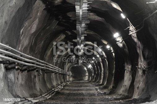 istock Mine incline with gravel road 185092273