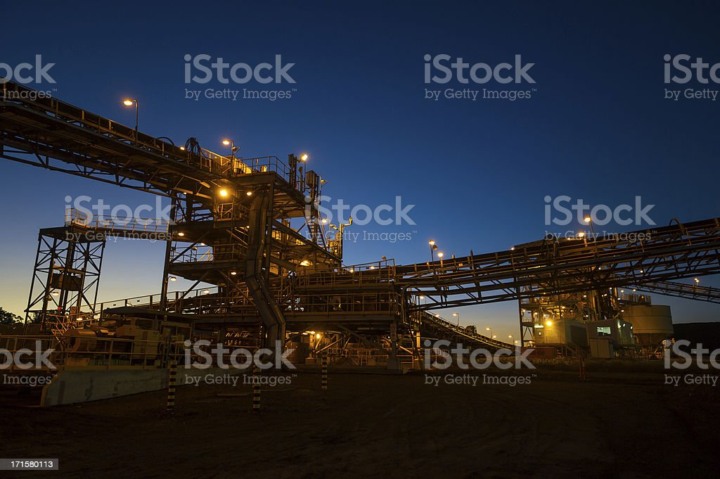 Mine processing infrastructure at sunrise stock photo