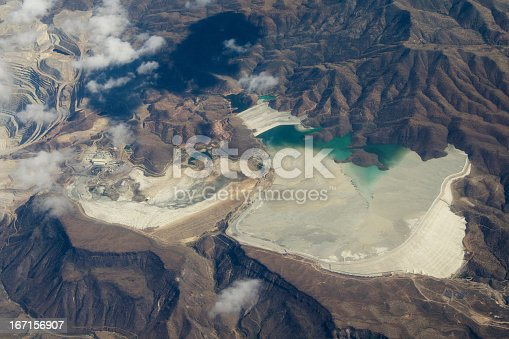 Aerial view of mine tailings from the Bagdad Mine, an open pit copper mine in Bagdad, Arizona, USA. Mine is just off to the left.