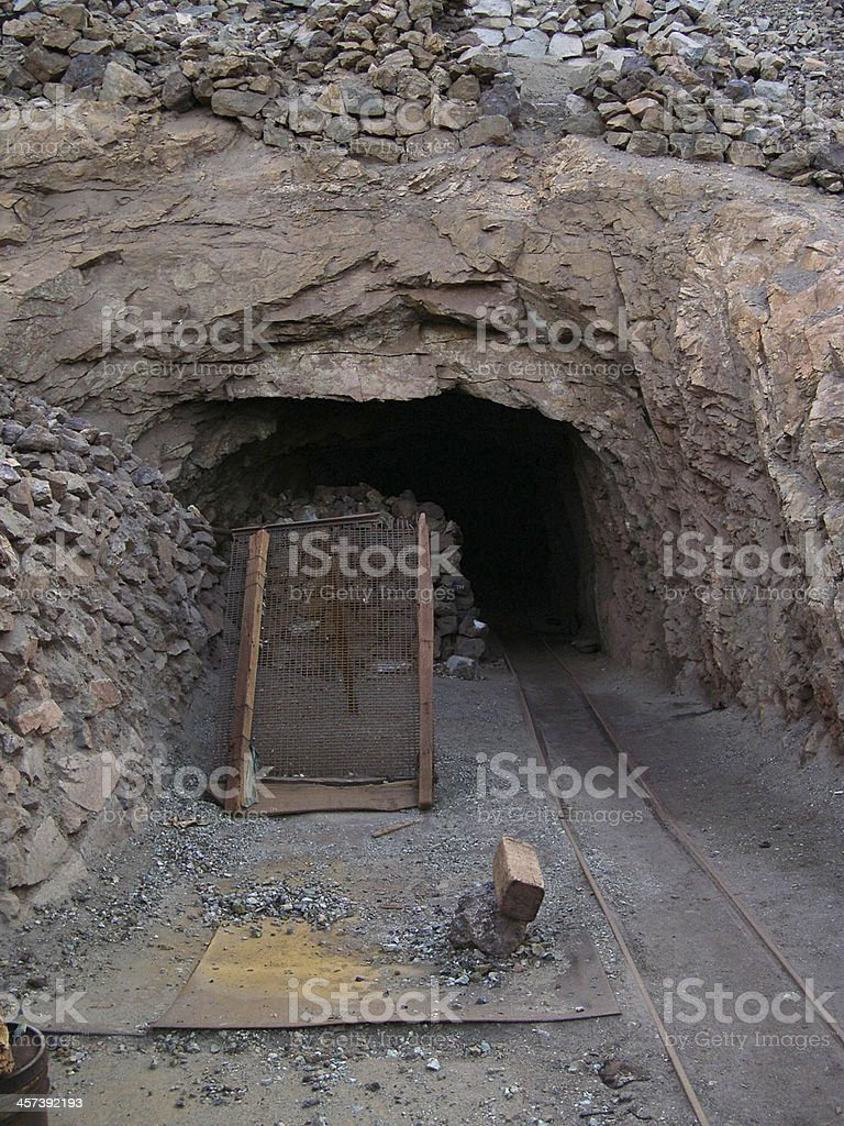 Mine with railroad track - underground mining stock photo