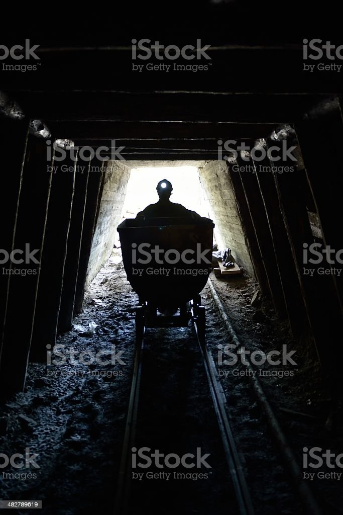 Miner and mine stock photo