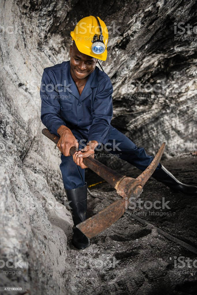 Miner digging a tunnel royalty-free stock photo