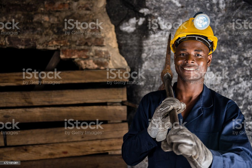 Miner holding a pick axe stock photo