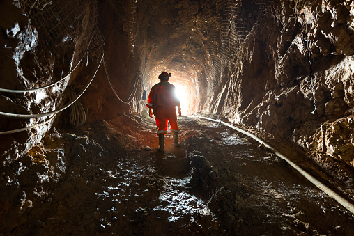 Region del Maule, Chile - April 02, 2016: Miner inside the access tunnel of an underground gold and copper mine.