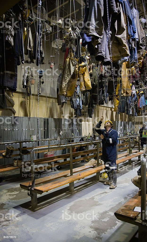 Miner retrieving his clothes at end of shift royalty-free stock photo
