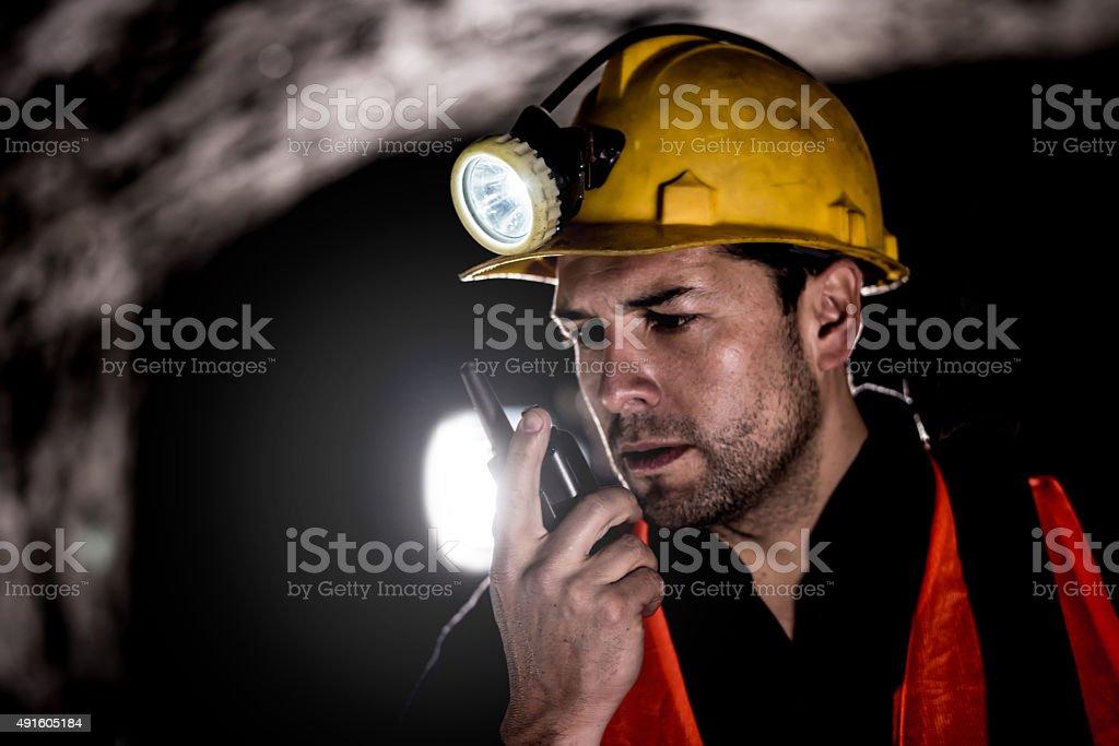 Miner talking on a walkie-talkie stock photo