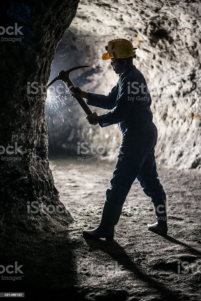 Miner working at a mine stock photo