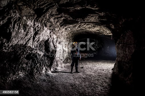 508140747 istock photo Miner working at a mine underground 490583158