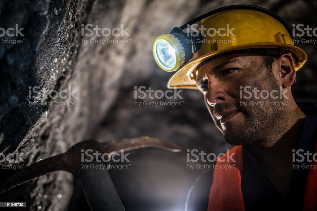 Miner working at a mine underground stock photo