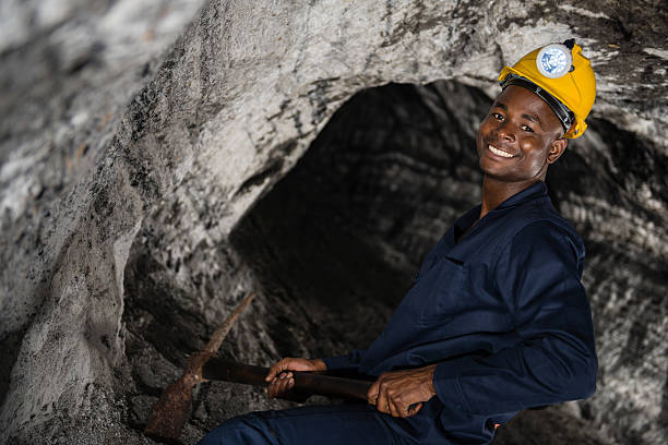 Miner working at the mine stock photo