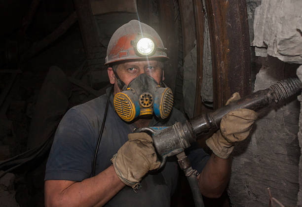 Miner working underground stock photo