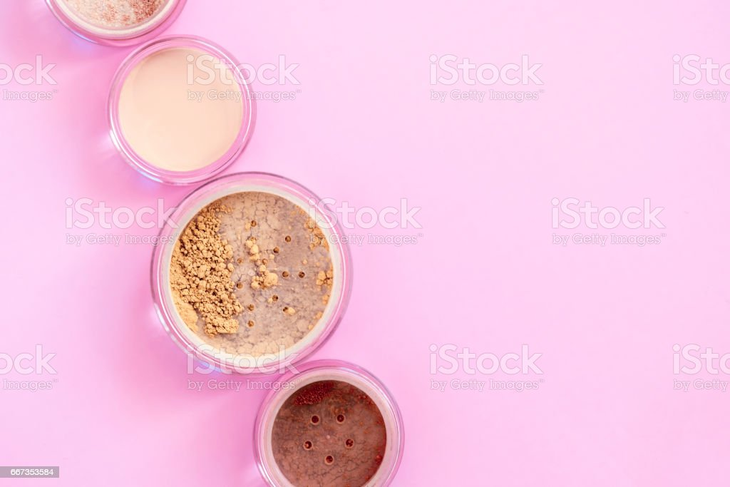 Mineral beauty makeup kit on pink stock photo