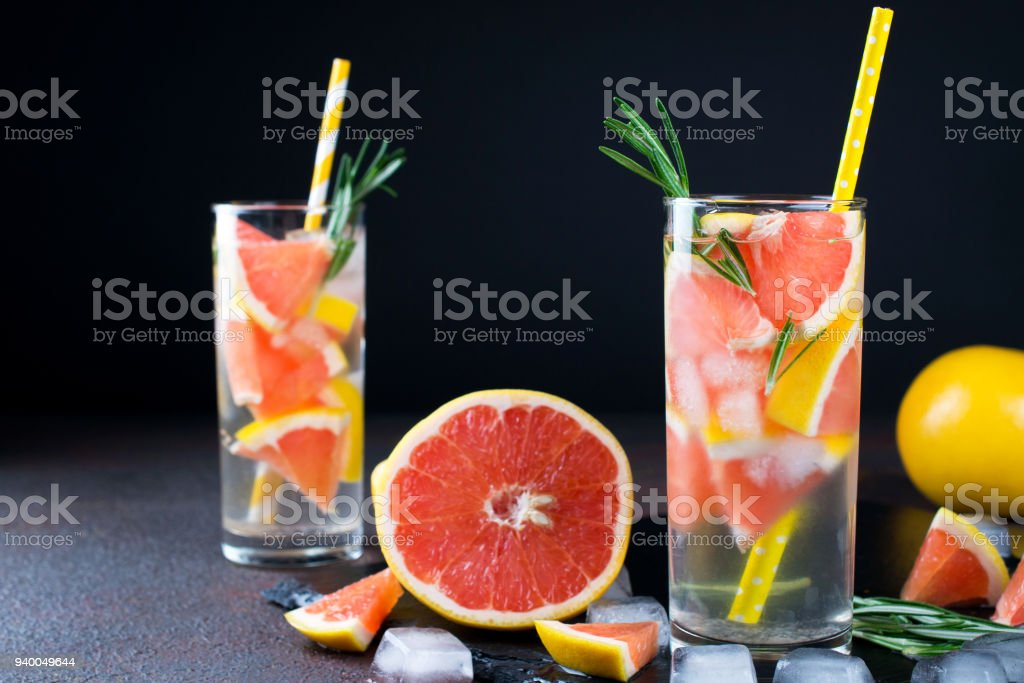 Mineral Infused Water With Grapefruit Ice And Rosemary On Dark Background  Homemade Detox Soda Water Recipe Stock Photo - Download Image Now