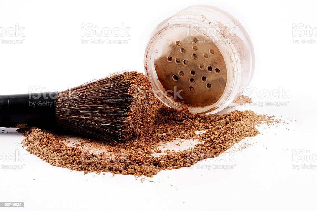 Mineral make-up jar spilled with brush royalty-free stock photo
