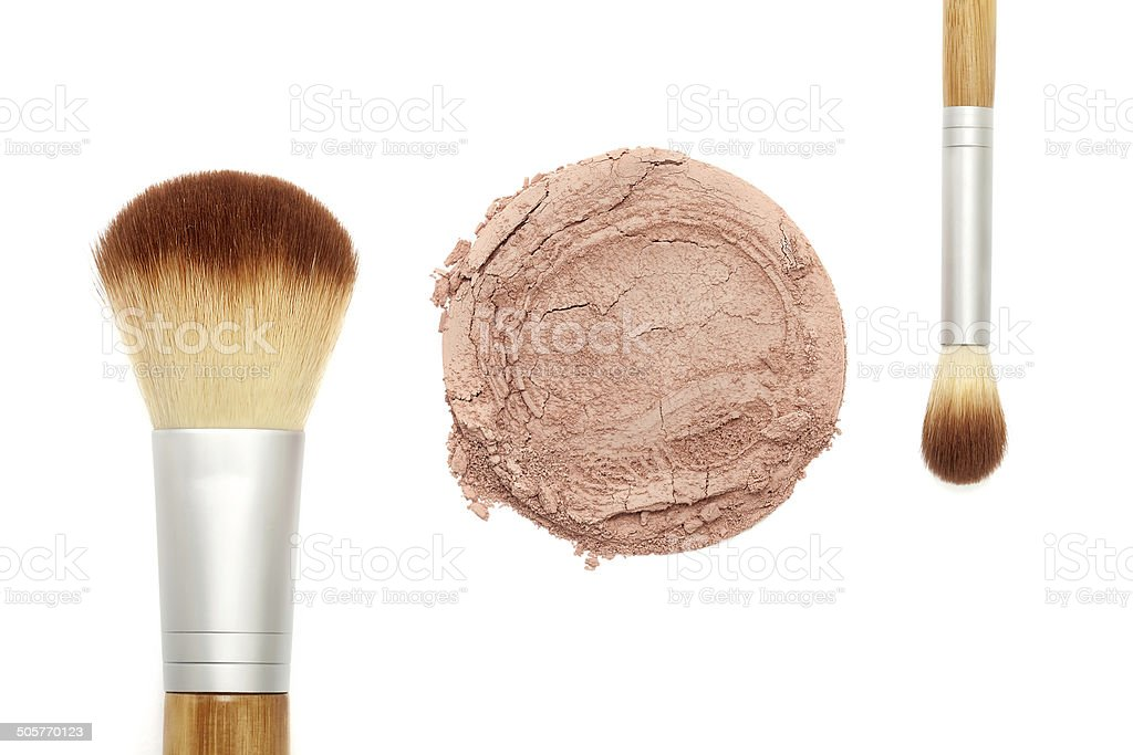 Mineral makeup powder with brush stock photo