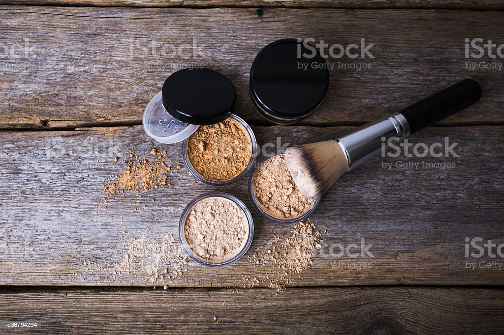 mineral powder of different colors with a brush for make-up stock photo