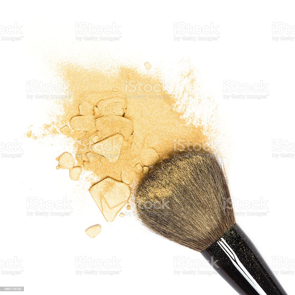 Mineral shimmer powder golden color with makeup brush stock photo
