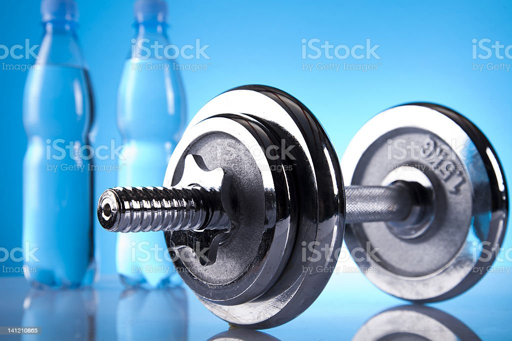 mineral water and dumbell royalty-free stock photo