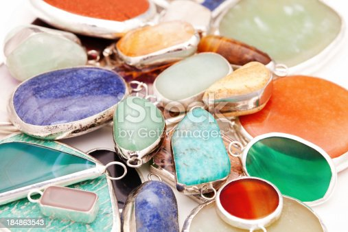 Pendants made of many different kind of colorful minerals and semi precious gems
