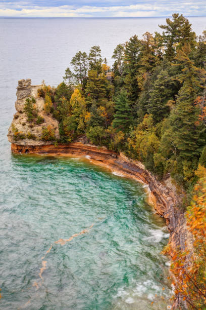 Miners Castle ablaze with fall color Miners Castle ablaze with fall color ablaze stock pictures, royalty-free photos & images