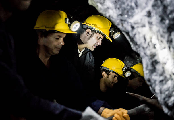 Miners digging a tunnel stock photo