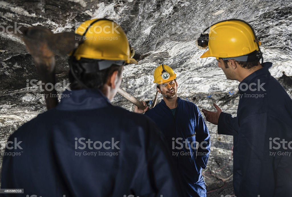 Miners talking royalty-free stock photo