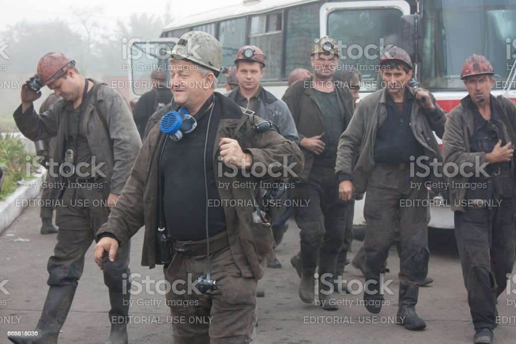Miners under my name Artyom near the bus stock photo
