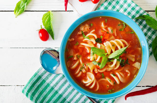 minestrone, italian vegetable soup with pasta. tomatoes soup. vegan food. top view. flat lay. - minestrone foto e immagini stock