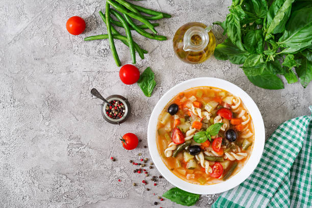 minestrone, italian vegetable soup with pasta. vegan food. top view. flat lay. - minestrone foto e immagini stock