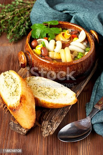 Minestrone soup. Vegetable soup with fresh tomato,  carrot,  corn, pepper, beans and pasta. Dish of italian cuisine