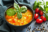 Minestrone soup. Vegetable soup with fresh tomato,  carrot,  corn, pepper, beans and  noodle. Dish of italian cuisine