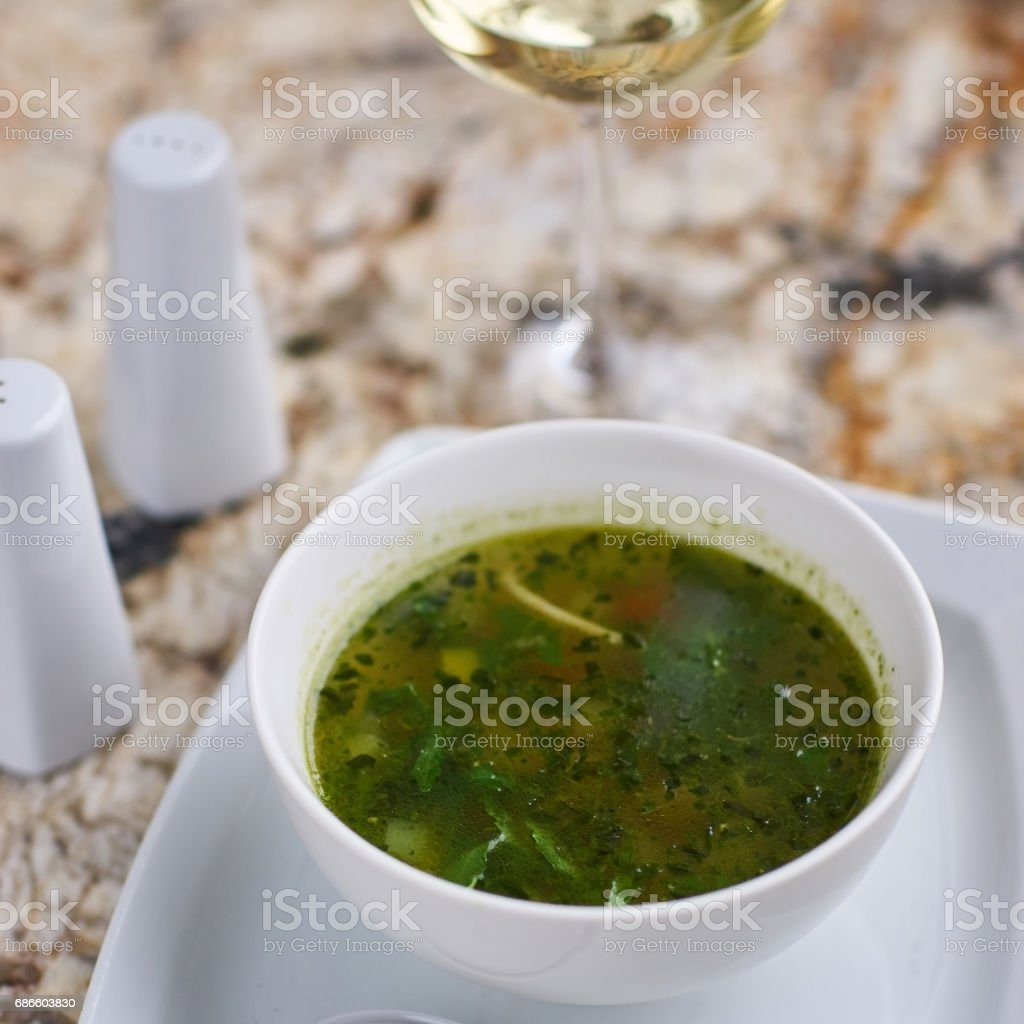 Minestrone soup with arugula in bowl royalty-free stock photo