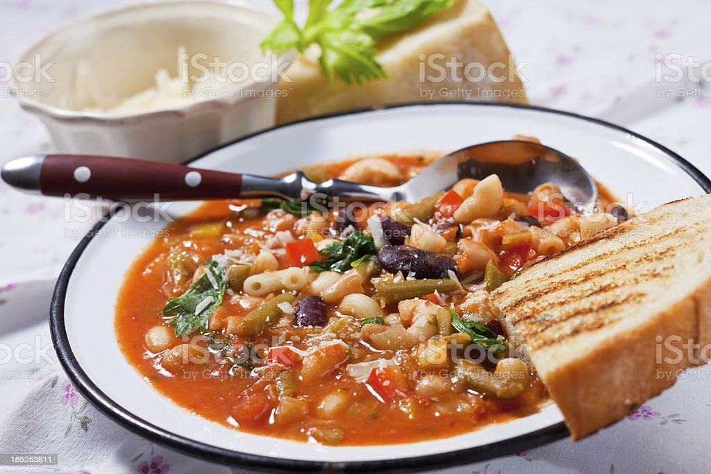 Minestrone soup with bread stock photo