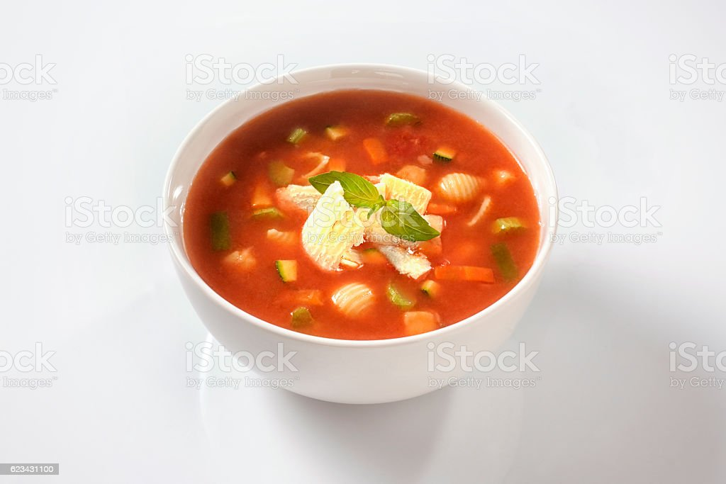 minestrone soup with cheese and basil stock photo