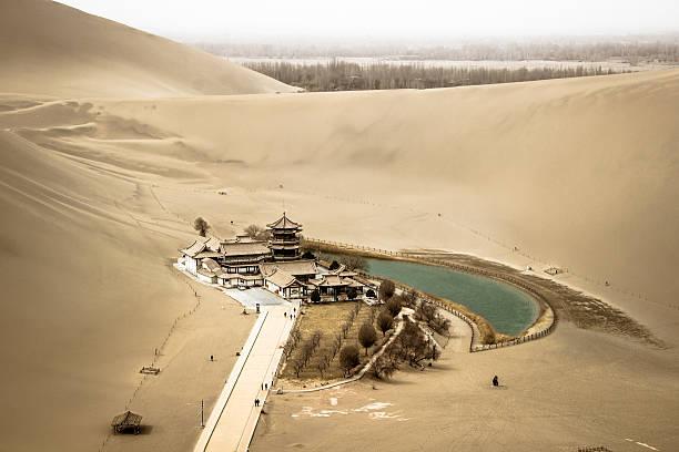 Mingsha shan esert and Crescent moon lake in Dunhuang, china stock photo