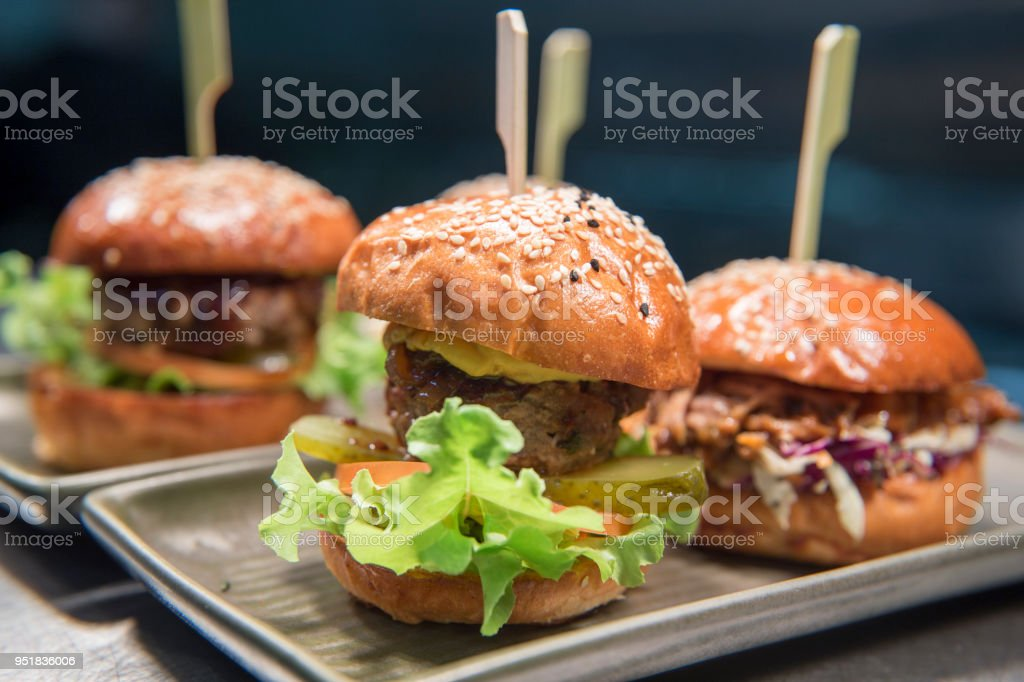 mini burgers are on the tray stock photo