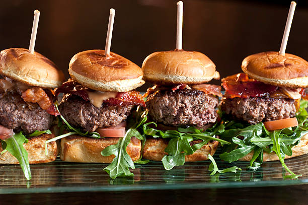 mini burgers - sliding stock photos and pictures