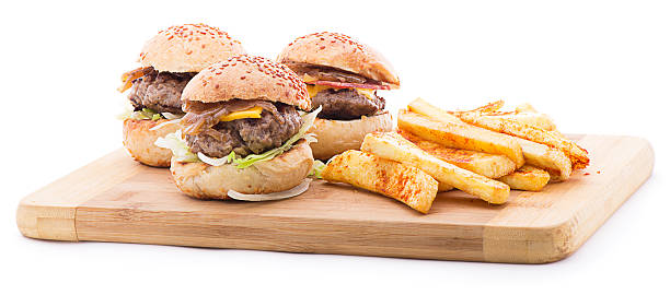 Mini Burgers Three different types of hamburgers with french fries isolated on white background slider burger stock pictures, royalty-free photos & images