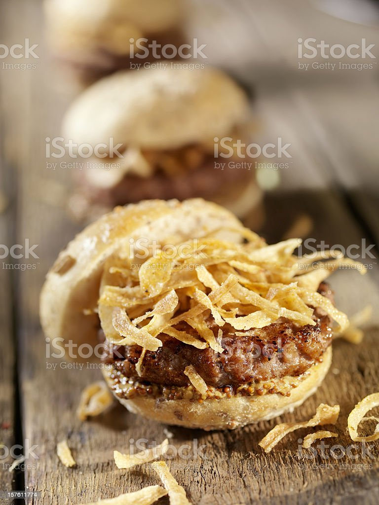 Mini Burgers with Crispy Onions and Grainy Mustard stock photo