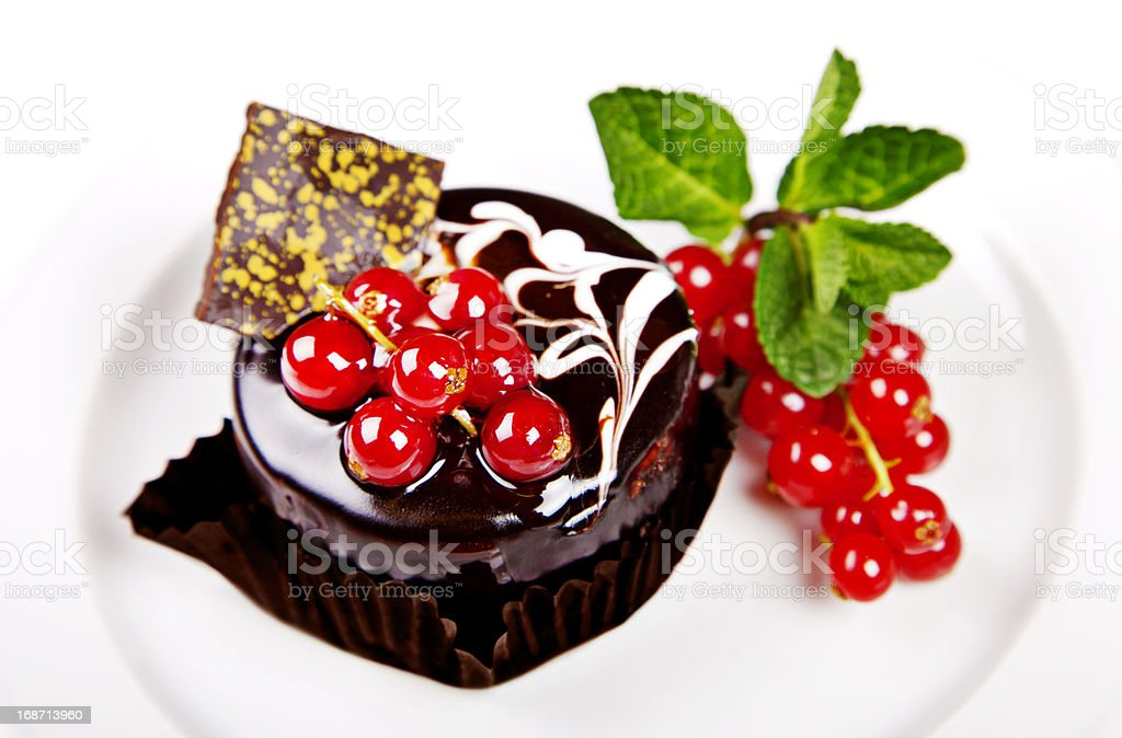Mini cake with chocolate, mint and berries royalty-free stock photo