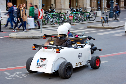 Vienna, Austria - November 3, 2017: Mini car and retro car driving on the city street, Vienna, Austria.
