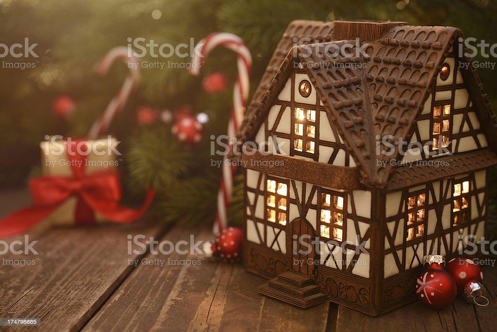 Mini ceramic cottage house with christmas decoration royalty-free stock photo