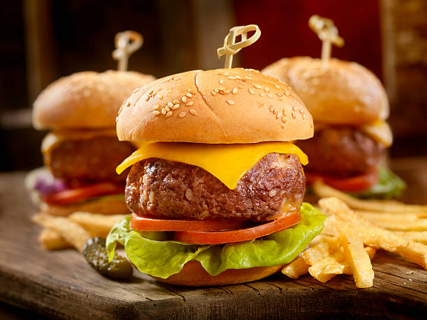 Mini CheeseBurgers with Fries Mini CheeseBurgers with Fries -Photographed on Hasselblad H3D2-39mb Camera slider burger stock pictures, royalty-free photos & images
