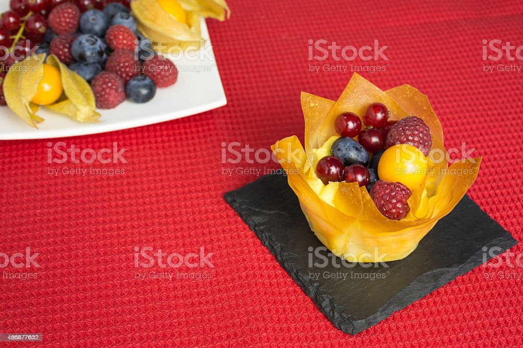 mini cheesecake with filo pastry and berries stock photo