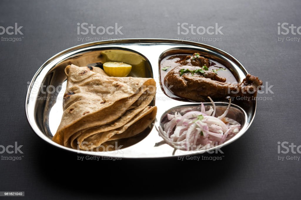 mini chicken curry thali with chapatiroti popular indian lunchdinner