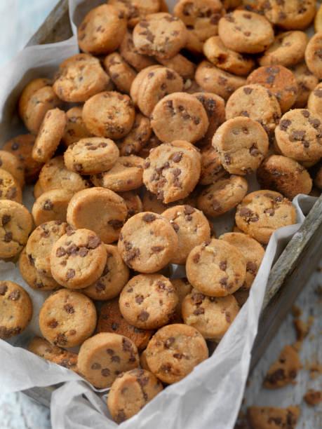 Mini Chocolate Chip Cookies Mini Chocolate Chip Cookies chocolate chip cookie stock pictures, royalty-free photos & images