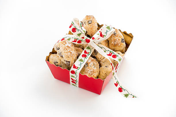 mini christstollen in a red tray with ribbon - marzipanbrot stock-fotos und bilder